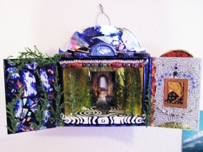 2008. Cigar box, magazine clippings, CD fragments, sequins, paper, plastic trees, paint, bottle caps, cellophane.